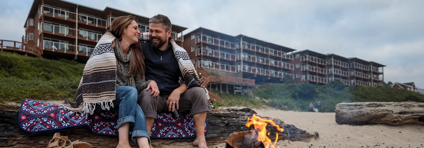 Couple with beach fire