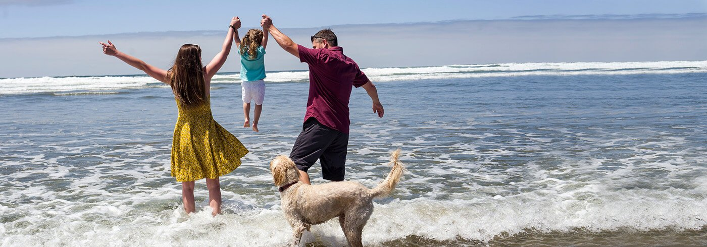 Family play in surf