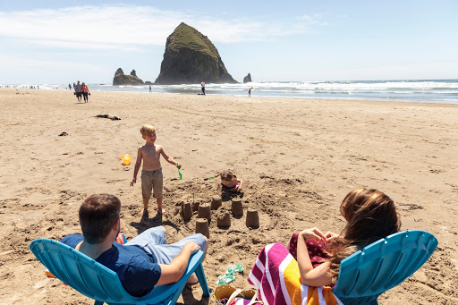 Family friendly beach with a view of Haystack Rock at Hallmark Resort Cannon Beach